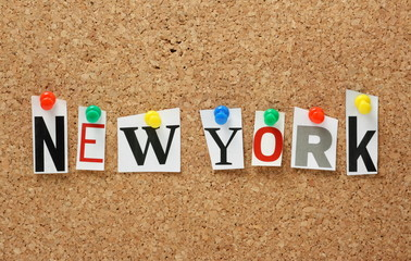 The place name New York on a cork notice board