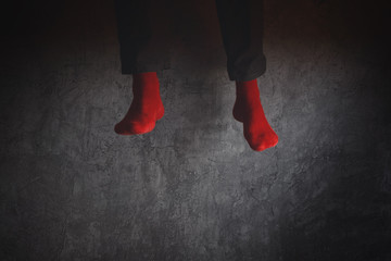 Young man in red socks jumping high in the air