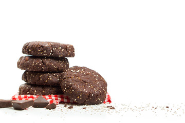 Healthy dark chocolate almond chia seed cookie stack on white