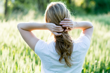 Blonde woman on wheat field