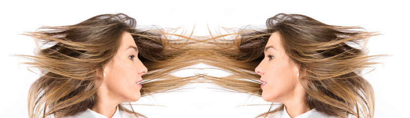 Young pretty girl moving her hair over white background