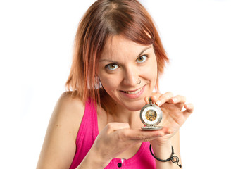 Redhead girl holding a wristwatch over white