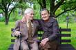Leinwanddruck Bild - Cute 80 plus year old married couple in their garden.