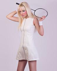 Beautiful blonde model posing in white dress