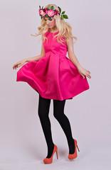 Beautiful blonde girl posing in elegant dress