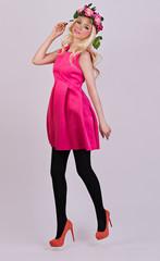 Beautiful blonde model posing in elegant dress