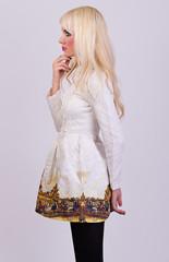 Beautiful blonde girl in elegant dress