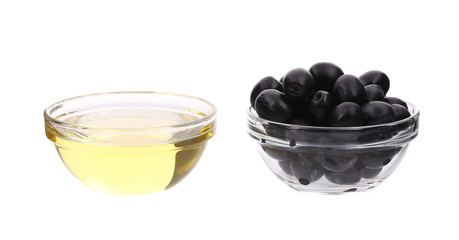 Sunflower oil and olives in glass bowl.