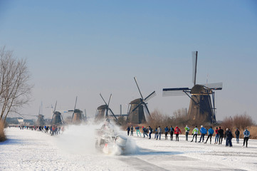 skaters near the mills of Kinderdijk