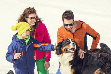 Family and their dog having fun in mountain