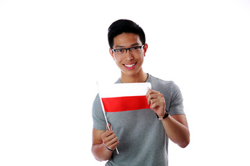 Happy asian man holding flag of Poland over white background