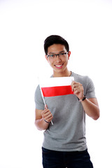 Smiling asian man holding flag of Poland over white background