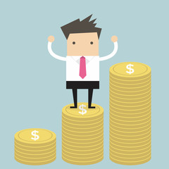 Businessman standing on gold coin