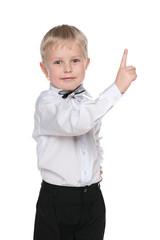 Smiling little boy shows his finger up