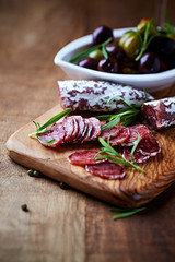 Mediterranean Sausage with Rosemary on a Chopping Board