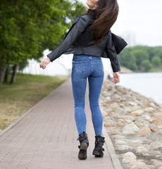 Beautiful female ass in blue jeans