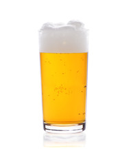 Glass of beer with froth isolated on white