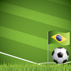 Soccer ball and the brazil flag