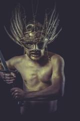Hero, golden deity, man with wings and gold helmet