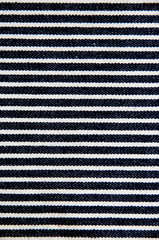 Navy blue striped denim texture.