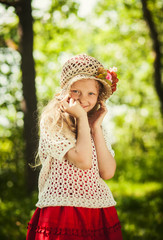 Funny little girl in hat posing