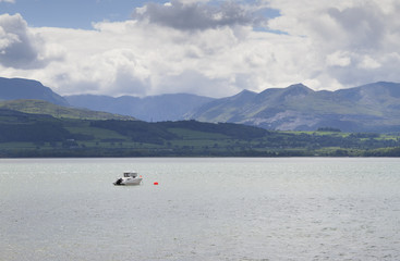 Single boat moored near Beaumaris in Anglesey, North Wales, UK