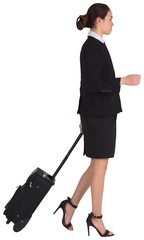 Businesswoman pulling her suitcase