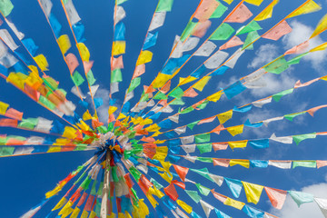 Buddhist tibetan prayer flags waving in the