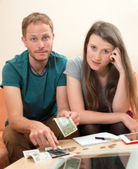 young man and woman counting her money