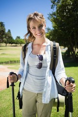 Fit smiling woman going for a hike