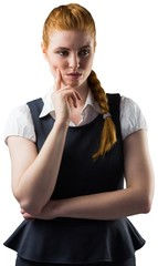 Thinking pretty redhead businesswoman with finger on face