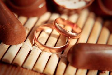 Wedding gold rings on chocolates