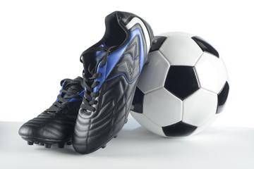 Botas de fútbol y balón
