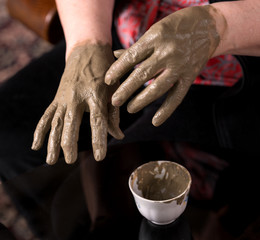 Woman applying spa cosmetic clay cream
