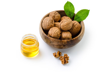 Walnuts in a wooden bowl with clipping path
