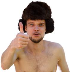 Мужик в шапке-ушанке показывает большой палец