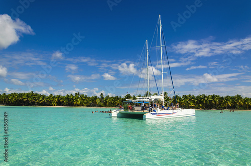 White catamaran on azure water against blue sky