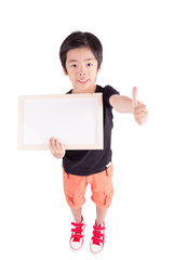 school boy holding a blank whiteboard, isolated on white backgro