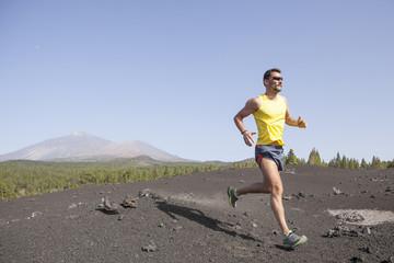 Man running outdoors, cross country trail run