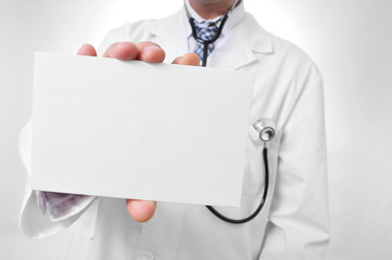 doctor showing a blank signboard