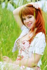 redhead girl in field