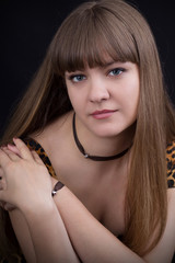 Portrait of girl in leopard print dress