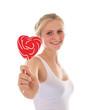 Junges Mädchen mit Herz-Lutscher