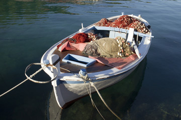 Wooden fishing boat with nets