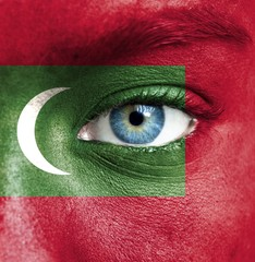 Human face painted with flag of Maldives