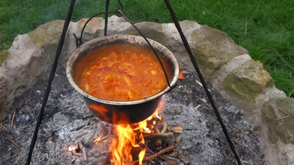 Traditional hungarian paprika potatoes is cooking on a campfire
