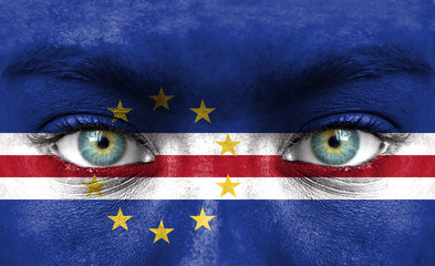 Human face painted with flag of Cape Verde
