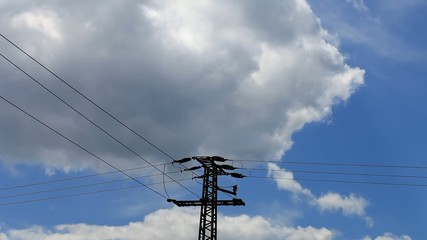 High Voltage Post against blue sky and clouds