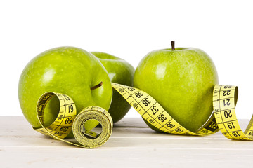 green apples with tape measure, concept of healthy diet