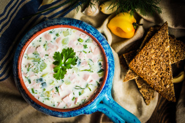 Cold summer soup on rustic background